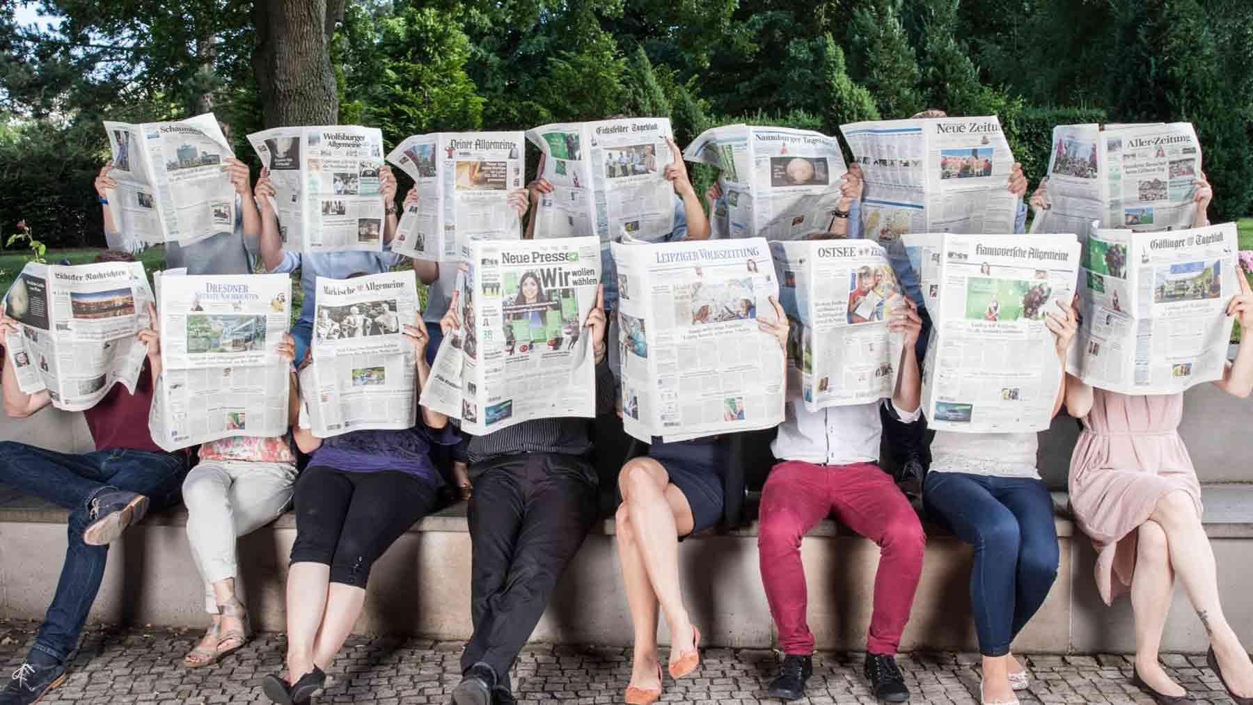Personen mit Zeitungen der Madsack Titel